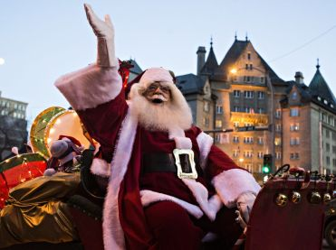 Santa waving from his sleigh during the annual Edmonton Santa Claus Parade. Source: https://postmediaedmontonjournal2.files.wordpress.com/2017/11/qmi_qmi_es20151121cm008.jpg?quality=80&strip=all&w=371&h=277&crop=1