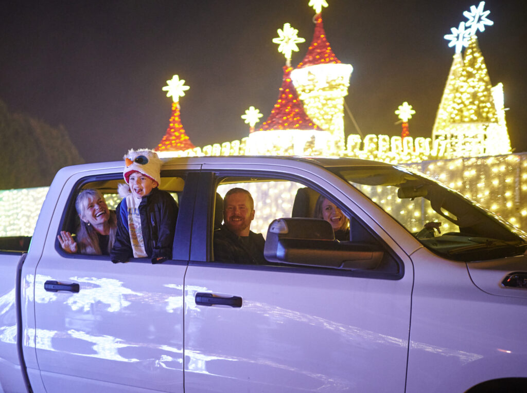 family in a car at our Christmas light festival