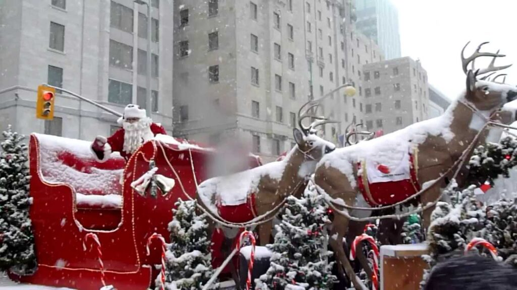 Santa riding in his sleigh during the parade in Ottawa. Source: https://i.ytimg.com/vi/TRTljOQoTW4/maxresdefault.jpg
