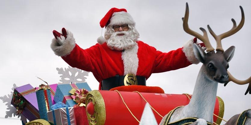 A close-up of Santa, located on the top of his sleigh. Source: https://dynamicmedia.zuza.com/zz/m/original_/a/a/aadbd986-609e-43c8-8f8c-39b18666f1fb/3hSantaClausParade1120___Super_Portrait.jpg