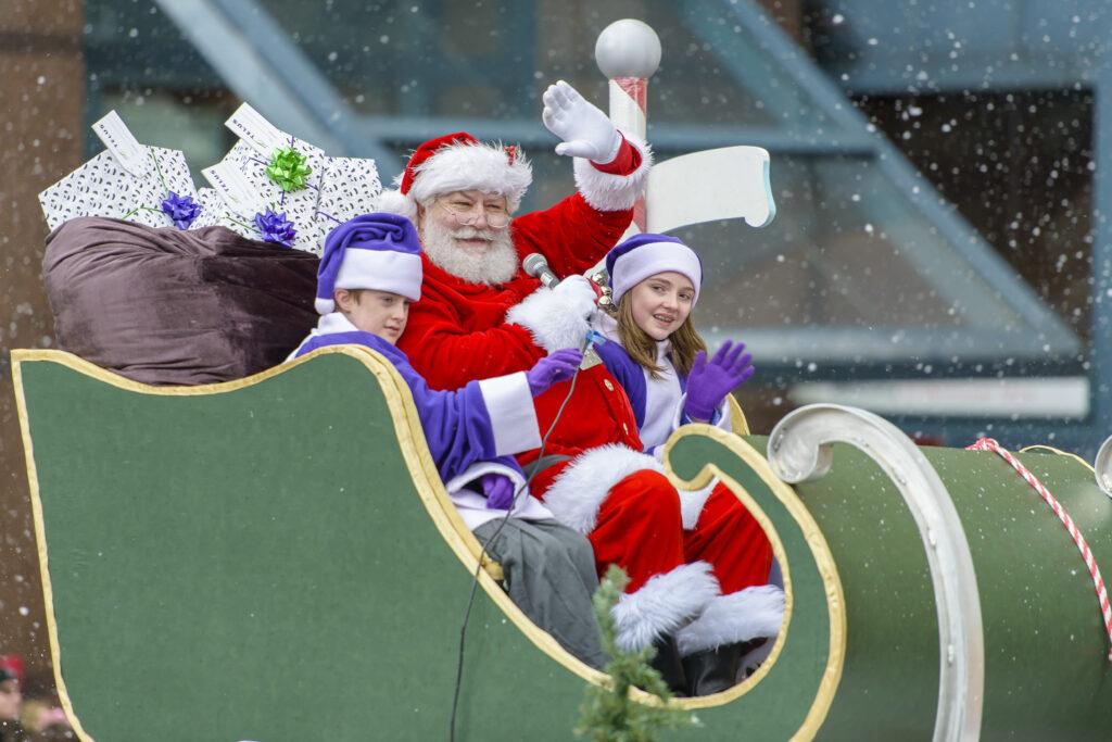kids and santa on sleigh